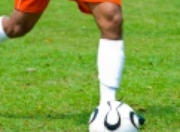Image of man playing soccer